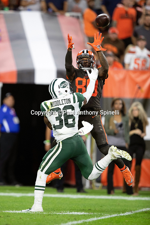 Cleveland Browns wide receiver Jarvis Landry (80) leaps and catches a third quarter pass for a gain of 29 yards and a first down with goal to go at the Jets 1 yard line while covered by New York Jets defensive back Doug Middleton (36) during the 2018 NFL regular season week 3 football game against the New York Jets on Thursday, Sept. 20, 2018 in Cleveland. The Browns won the game 21-17. (©Paul Anthony Spinelli)