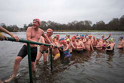 © Licensed to London News Pictures. 25/12/2017. London, UK. Competitors leave the water after the race. Members of the Serpentine Swimming Club brave the cold waters at the Serpentine Lake in Hyde Park, London to compete for the traditional Peter Pan Cup on Christmas Day, December 25, 2017. Photo credit: Ben Cawthra/LNP