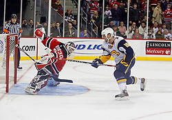 December 28, 2007; Newark, NJ, USA;  New Jersey Devils goalie Martin Brodeur (30) makes a right pad save against Buffalo Sabres center Tim Connolly (19) during the overtime shootout of the NJ Devils 2-1 win at the Prudential Center in Newark, NJ.  Brodeur stopped all 3 shots in the shootout.