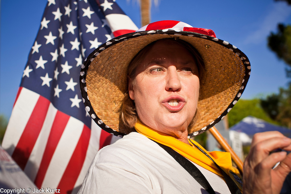 15 APRIL 2011 - PHOENIX, AZ: CAROL CONDIT, a Tea Party supporter from Phoenix, AZ, argues with immigrants' rights supporters at a Tea Party rally in Phoenix Friday. About 500 supporters of the Tea Party movement rallied Friday at the Arizona State Capitol to mark tax day. They protested high taxes, the federal deficit, the debt limit and immigration policy. About 50 pro-immigrant protesters held a counter rally at the capitol. At least one person was arrested, and others led away by police after several shouting matches between Tea Party supporters and the immigrants rights protesters broke out.     Photo by Jack Kurtz