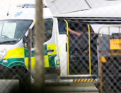 © Licensed to London News Pictures. 30/10/2015. London, UK. A man being treated in the back of an ambulance after a plane carrying former Guantanamo Bay detainee Shaker Aamer arrived at Biggin Hill airport.  Photo credit: Ben Cawthra/LNP