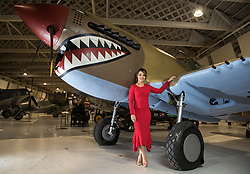 © Licensed to London News Pictures. 21/11/2018. London, UK.  <br /> TV presenter and Strictly Come Dancing star Katie Piper poses for a photograph in front of a Curtiss Kittyhawk aircraft in the Royal Air Force Museum London to launch the National Lottery's Thanks To You campaign in London, England on November 21, 2018. The Thanks To You promotion which runs from December 3 until December 9 sees venues, which have received Lottery funding, offering free offers and/or free entry to people in possession of a National Lottery ticket. Some of the UK's best-loved venues will be taking part, including: the Natural History Museum, Science Museum, Kew Gardens, Eden Project, Jodrell Bank, the National Railway Museum, V&A Dundee, National Museum Wales and over 100 National Trust sites.  Photo credit: Oli Scarff/LNP