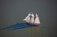 Aerial photography of the Pride of Baltimore sailing schooner in the Baltimore Harbor.