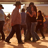 Couples and other party goers dance to the music of Country Alibi during the annual Fourth of July Party in the Park Monday in Gallup.