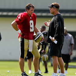 01 August 2009: New Orleans Saints quarterback Drew Brees (9) and head coach Sean Payton talk on the field during New Orleans Saints training camp at the team's practice facility in Metairie, Louisiana.