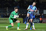 Tranmere Rovers goalkeeper Scott Davies (1) makes an important save  from Wycombe Wanderers midfielder David Wheeler (7) during the The FA Cup match between Wycombe Wanderers and Tranmere Rovers at Adams Park, High Wycombe, England on 20 November 2019.