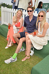 Left to right, MARTHA WARD, OTIS FERRY and ASTRID HARBORD at the St.Regis International Polo Cup at Cowdray Park, Midhurst, West Sussex on 17th May 2014.