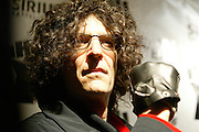 Howard Stern raises his fist in triumph when arriving at the Hard Rock Cafe, Friday, Dec. 16, 2005, in New Yor's Times Square, for a party to celebrate the launch of his career at Sirius Satellite Radio.