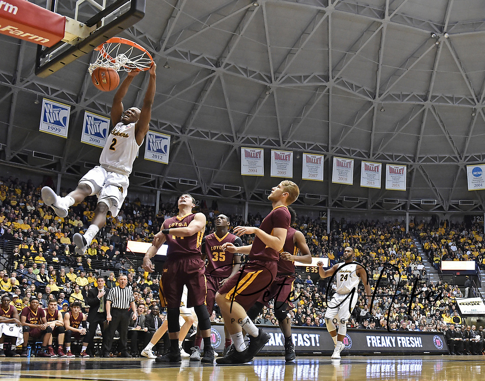 Wichita State Shockers guard Daishon Smith #2 drives to the basket for a dunk against the Loyola-Chicago Ramblers during the first half at Charles Koch Arena.