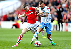 Ryan Kent of Barnsley tackles Jack Hunt of Sheffield Wednesday - Mandatory by-line: Robbie Stephenson/JMP - 01/04/2017 - FOOTBALL - Oakwell Stadium - Barnsley, England - Barnsley v Sheffield Wednesday - Sky Bet Championship