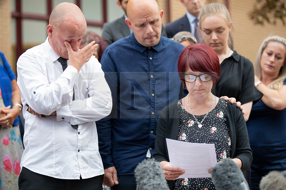 © Licensed to London News Pictures. 18/07/2018. Woking, UK. The family of Private (Pte) Sean Benton leave Woking Coroner's Court after hearing the coroner's verdict. Pte Benton's sister Tracy Lewis reads a statement as Sean's twin brother Tony Benton struggles with his emotions (L) after they heard the coroner's verdict that Sean died of self inflicted gunshot wounds to the chest. Pte Sean Benton was found with five gunshot wounds to his chest at Deepcut army base in 1995. Photo credit: Peter Macdiarmid/LNP