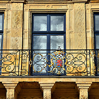 Grand Ducal Palace Coat of Arms in Luxembourg City, Luxembourg <br /> Behind this coat of arms and balcony, in the Palais Grand-Ducal, lives the world&rsquo;s only remaining Grand Duchy. Since 1815, Luxembourg&rsquo;s head of state, called a Grand Duke, is a constitutional monarch yet their government is a representative democracy with elected officials.