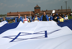 May 2, 2019 - Oswiecim, Poland - Participants of the March of the Living in the former Nazi-German Concentration and Extermination Camp Auschwitz II Birkenau in Oswiecim. The annual march is part of the educational program. Jewish students from all over the world come to Poland and study the remains of the Holocaust. Participants march in silence, three kilometers from Auschwitz I to Auschwitz II Birkenau, the largest Nazi complex of concentration camps built during World War II. (Credit Image: © Damian Klamka/ZUMA Wire)