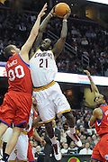 Feb. 27, 2011; Cleveland, OH, USA; Cleveland Cavaliers power forward J.J. Hickson (21) trys to dunk over Philadelphia 76ers center Spencer Hawes (00) during the second quarter at Quicken Loans Arena. Mandatory Credit: Jason Miller-US PRESSWIRE