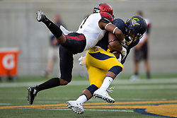 BERKELEY, CA - SEPTEMBER 12:  Tight end Stephen Anderson #89 of the California Golden Bears is tackled by defensive back JJ Whittaker #7 of the San Diego State Aztecs during the first quarter at California Memorial Stadium on September 12, 2015 in Berkeley, California. The California Golden Bears defeated the San Diego State Aztecs 35-7. (Photo by Jason O. Watson/Getty Images) *** Local Caption *** Stephen Anderson; JJ Whittaker