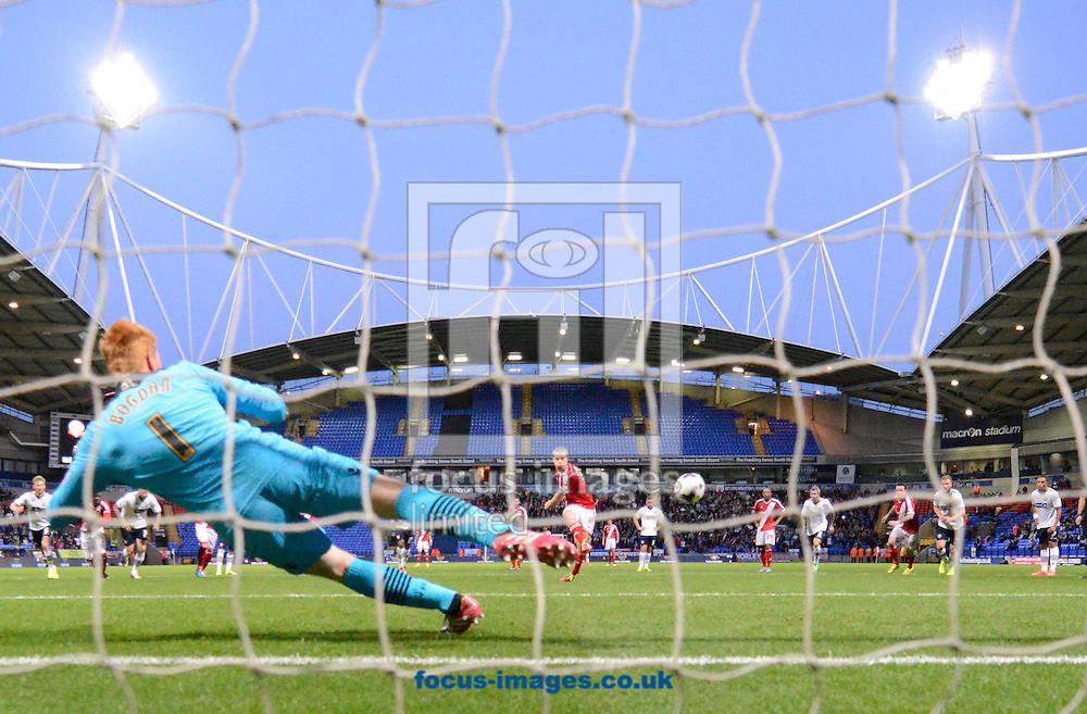 Grant Leadbitter of Middlesbrough beats Bolton Wanderers goalkeeper Adam Bogdan from the penalty spot to make it 1-1 during the Sky Bet Championship match at the Macron Stadium, Bolton<br /> Picture by Russell Hart/Focus Images Ltd 07791 688 420<br /> 19/08/2014