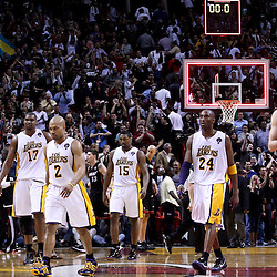 March 10, 2011; Miami, FL, USA; Los Angeles Lakers players walk off the court following a loss to the Miami Heat at the American Airlines Arena. The Heat defeated the Lakers 94-88.   Mandatory Credit: Derick E. Hingle