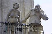 Statues on a balcony.