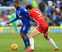 Junior Hoilett of Cardiff City under pressure from George Friend of Middlesbrough - Mandatory by-line: Nizaam Jones/JMP - 17/02/2018 -  FOOTBALL - Cardiff City Stadium - Cardiff, Wales -  Cardiff City v Middlesbrough - Sky Bet Championship