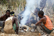 Africa, Tanzania, Lake Eyasi, Hadza tribe. A small tribe of hunter gatherers AKA Hadzabe Tribe. A group of men around a fire