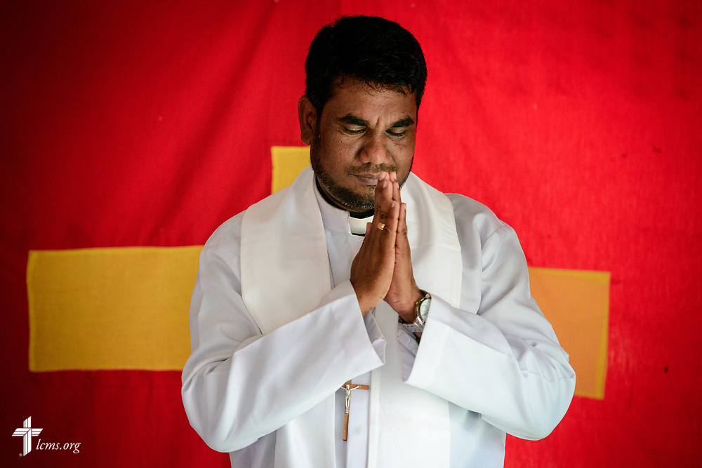 The Rev. P. Gnanakumar leads worship on the Eila rubber plantation in the Sabaragamuwa Province of Sri Lanka on Sunday, Jan. 21, 2018. LCMS Communications/Erik M. Lunsford
