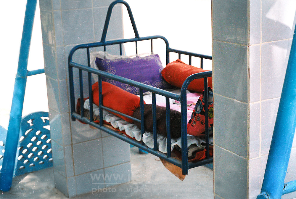 Pakistan, Karachi, 2004. Babies that are unwanted can be left in these cradles, which are placed outside every Edhi Welfare Center.