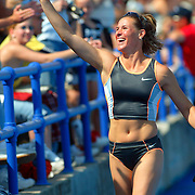 DRAKE -- des moines, april 26 == Stacy Dragilia runs a victory lap after her pole vault victory at the Drake Relays Saturday.  photo by david peterson s