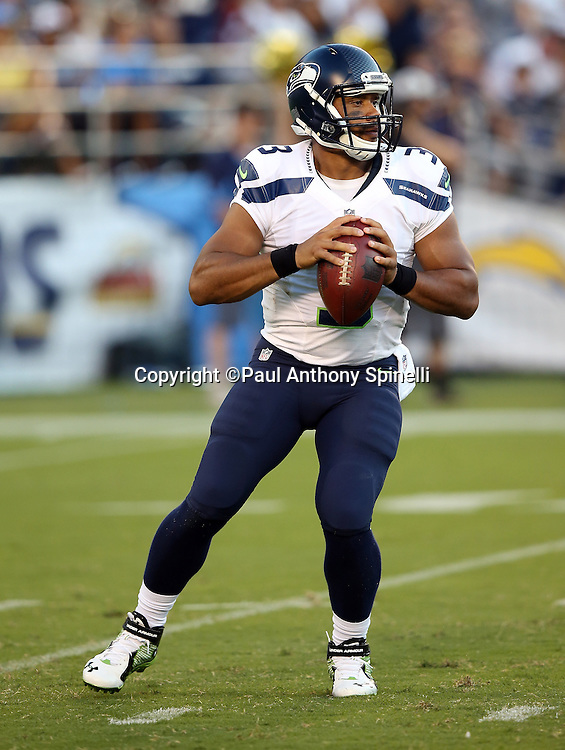 Seattle Seahawks quarterback Russell Wilson (3) drops back to pass during the 2015 NFL preseason football game against the San Diego Chargers on Saturday, Aug. 29, 2015 in San Diego. The Seahawks won the game 16-15. (©Paul Anthony Spinelli)