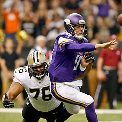 Sep 21, 2014; New Orleans, LA, USA; Minnesota Vikings quarterback Matt Cassel (16) is pressured by New Orleans Saints defensive end Akiem Hicks (76) during the first quarter of a game at Mercedes-Benz Superdome. Mandatory Credit: Derick E. Hingle-USA TODAY Sports