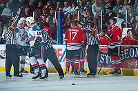KELOWNA, CANADA - APRIL 8: Referees Mike Campbell and Mark Pearce make penalty calls against the Kelowna Rockets and the Portland Winterhawks on April 8, 2017 at Prospera Place in Kelowna, British Columbia, Canada.  (Photo by Marissa Baecker/Shoot the Breeze)  *** Local Caption ***