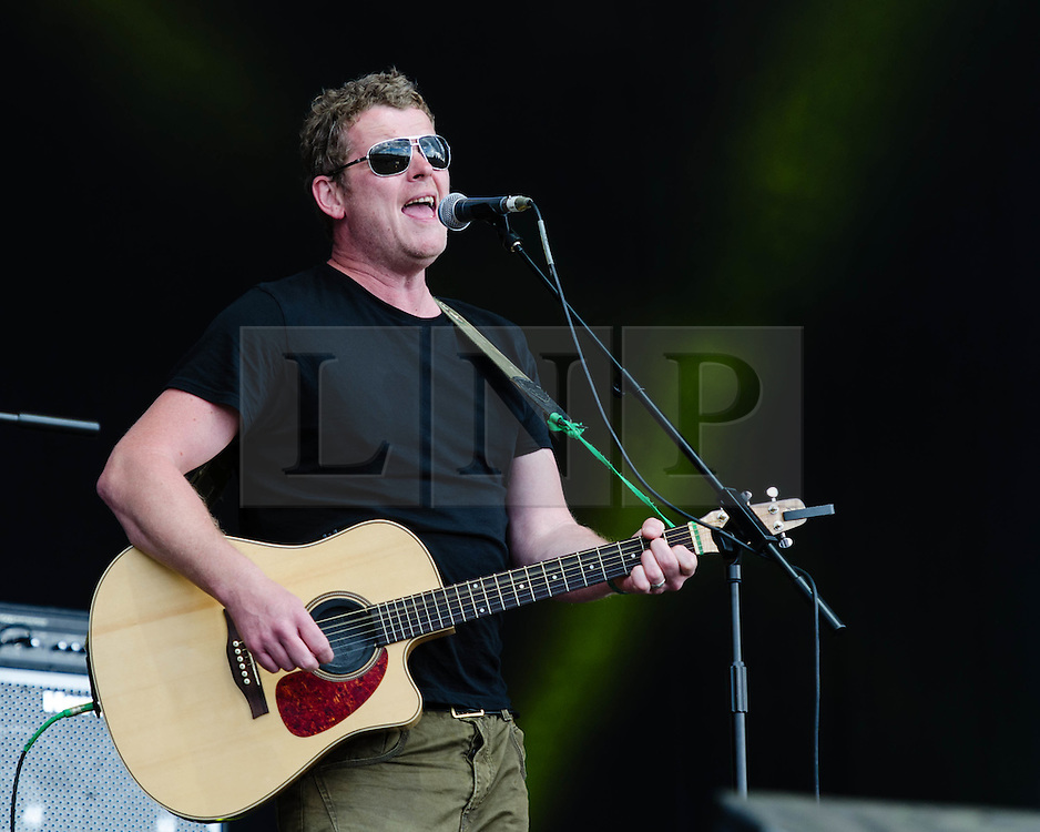 """© Licensed to London News Pictures. 31/07/2012. London, UK.  Dodgy perform live at BT London Live, Hyde Park.  Dodgy are an English power pop rock trio, that rose to prominence during the Britpop era of the 1990s. They are best known for their hits """"Staying Out for the Summer"""", """"If You're Thinking of Me"""", and """"Good Enough"""".  In this pic - Nigel ClarkPhoto credit : Richard Isaac/LNP"""