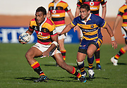 Savenaca Tokula (Waikato) with Nigel Hunt preparing to tackle during the Air New Zealand Cup rugby match between Waikato and Bay of Plenty won by BOP 32-16 at Bay Park Stadium, Tauranga, New Zealand, Saturday 22 August 2009. Photo: Stephen Barker/PHOTOSPORT