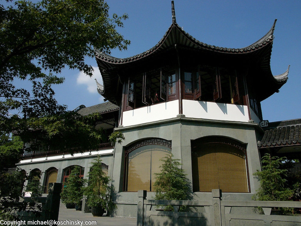 Color photo of a chinese villa in a park in Hangzhou