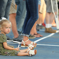 Ava Claire Young, 2, holds her canlde at Monday's vigil her her cousin, Maggie Riley, and Brandon Coward who were killed in a car accident over the weekend.