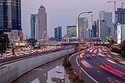 Israel, Tel Aviv, Long exposure Night shot of Ayalon highway looking north with a dramatic sky background