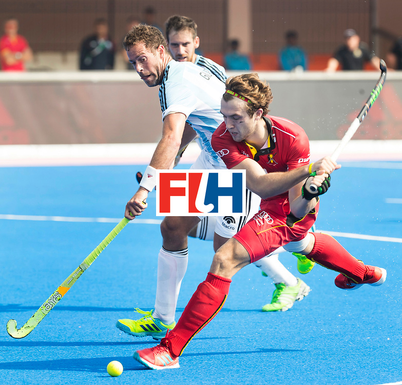 BHUBANESWAR - The Odisha Men's Hockey World League Final . Match ID 03. Argentina v Belgium. Manu Stockbroekx (Bel) with Juan Gilardi (Arg)  WORLDSPORTPICS COPYRIGHT  KOEN SUYK