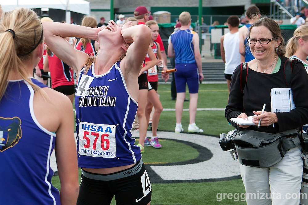 Idaho Statesman photojournalist Katherine Jones waits patiently as Rocky Mountain's Dana Snell celebrates their record setting 5A 4x800 meter relay performance at the Idaho High School State Track and Field Championships on May 17, 2013 at Eagle High School.