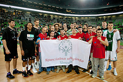 Players of Siena and Union Olimpija and players of Special Olympics  during basketball match between KK Union Olimpija and Montepaschi Siena (ITA) of 7th Round in Group D of Regular season of Euroleague 2011/2012 on December 1, 2011, in Arena Stozice, Ljubljana, Slovenia. Sena defeated Union Olimpija 63-57. (Photo by Vid Ponikvar / Sportida)