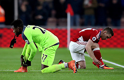 Divock Origi of Liverpool and Adam Forshaw of Middlesbrough tie their boot laces - Mandatory by-line: Robbie Stephenson/JMP - 14/12/2016 - FOOTBALL - Riverside Stadium - Middlesbrough, England - Middlesbrough v Liverpool - Premier League