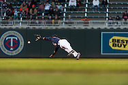 Eduardo Escobar #5 of the Minnesota Twins makes a diving attempt to stop a groundball during a game against the Miami Marlins in Game 2 of a split doubleheader on April 23, 2013 at Target Field in Minneapolis, Minnesota.  The Marlins defeated the Twins 8 to 5.  Photo: Ben Krause