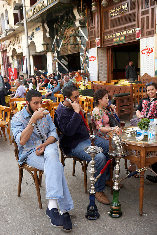 People in outdoor cafe with hookah, Cairo, Egypt
