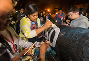 Houston ISD EMERGE students paint the cannon at Tufts University at the end of their 4-day tour of area colleges, June 5, 2014.