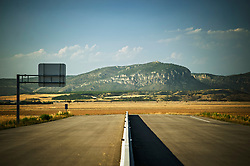 Highway A-14.<br /> Alguaire, Lleida, Catalunya.<br /> Highway A-14 began to be built where it was easiest to expropriate soil, far from all possible junctions. When successive budget cuts stopped the construction in 2012, all there was left was a 10 km long chunk of asphalt that goes from no place to nowhere. The works to connect it with the provincial capital started in 2013. Total cost: €84 million.
