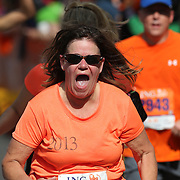 The Finish Line. Expressions of agony and ecstasy on the faces of athletes as they complete the ING Hartford Marathon, Bushnell Park, Hartford. Connecticut. USA. Hartford, Connecticut, USA. 12th October 2013. Photo Tim Clayton
