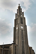 Low angle view of the designed modernist tower of the church of Notre-Dame du Raincy on May 24, 2009 in Le Raincy, Seine Saint Denis, France. Built in 1922-1923 by the architects and brothers Auguste and Gustave Perret, the cathedral was the first one to be built with reinforced concrete. The stained glass was created by Marguerite Hure based on sketches by Maurice Denis. Picture by Manuel Cohen