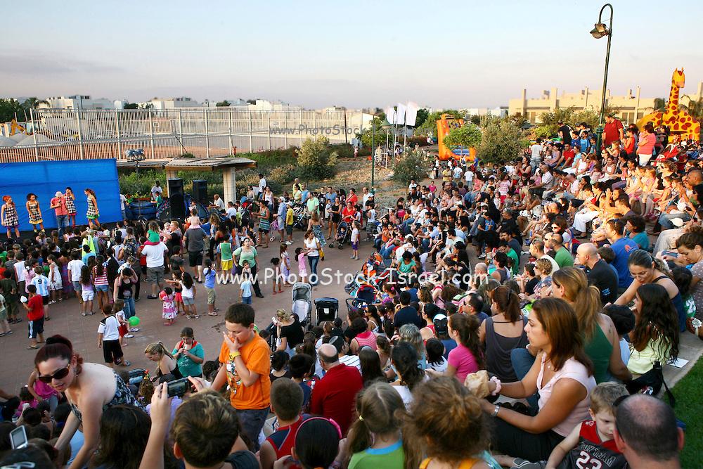 Israel, Netanya, Outdoor, Summer entertainment for children. large crowd of spectators