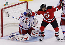 Oct 5, 2009; Newark, NJ, USA; New York Rangers goalie Henrik Lundqvist (30) makes a save through a screen by New Jersey Devils left wing Brian Rolston (12) during the third period at the Prudential Center. The Rangers defeated the Devils 3-2.