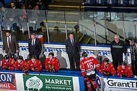 KELOWNA, CANADA - APRIL 8: Portland Winterhawks' coaches, Oliver David, Mike Johnston and Kyle Gustafson stand on the bench with equipment manager Mark Brennan against the Kelowna Rockets  on April 8, 2017 at Prospera Place in Kelowna, British Columbia, Canada.  (Photo by Marissa Baecker/Shoot the Breeze)  *** Local Caption ***
