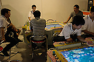 Zhengzhou, June 22nd 2013<br /> Foxconn workers playing at a video games parlor. Some such parlors are gambling dens.