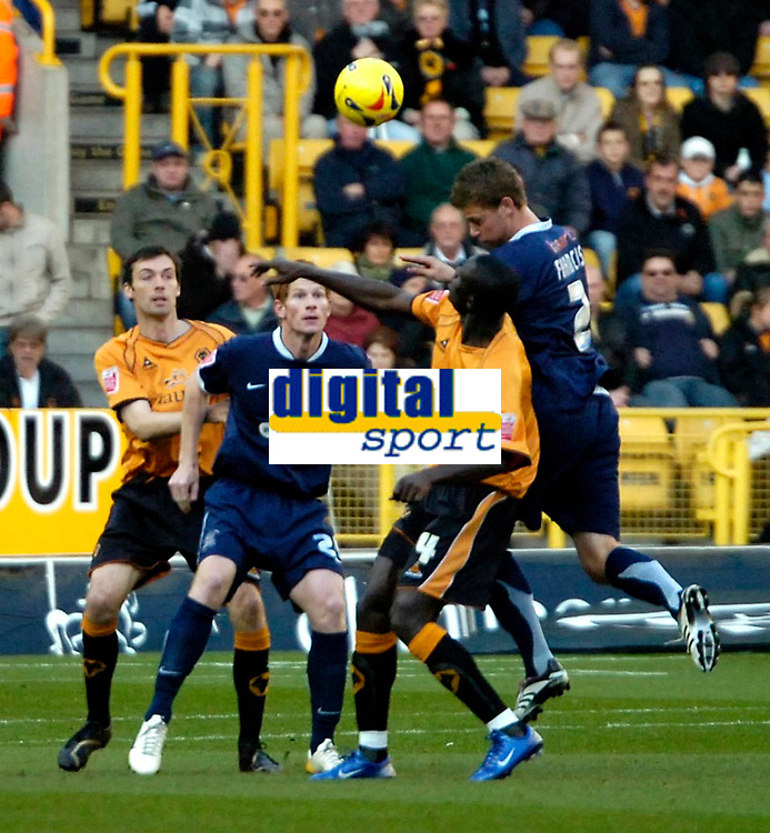 Photo: Ed Godden.<br /> Wolverhampton Wanderers v Southend United. Coca Cola Championship. 04/11/2006. Wolves' Seyi Olofinjana (2nd right) is approached from behind by Southend's Simon Francis.